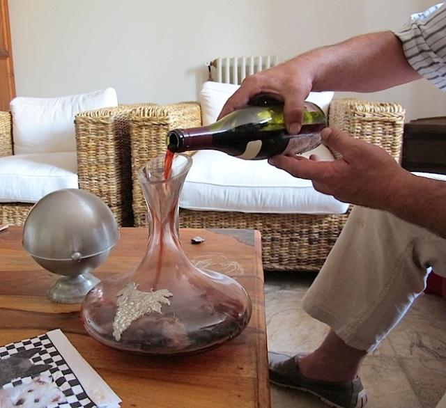 Decanting the wine.
