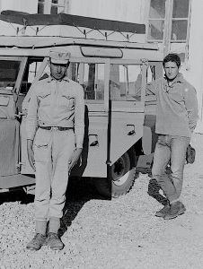My friend Ian (hand on the rear door), and a border guard who watched over our Landrover throughout the night, Afghanistan.