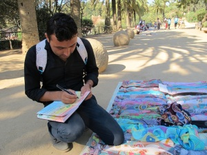 Muhamed signing my concertina book.  Bev bought a number of scarves to give away as gifts.