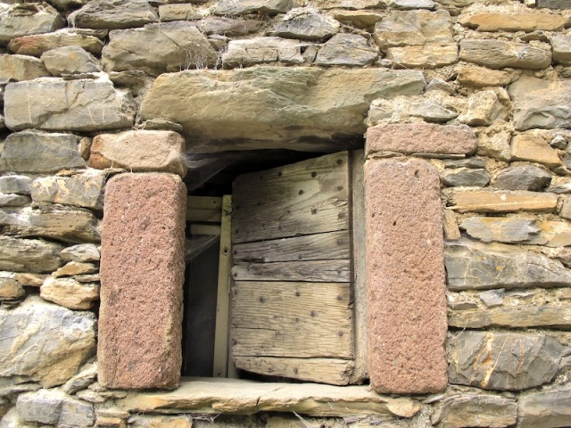 Beautiful window in the barn with hand hewn jambs.