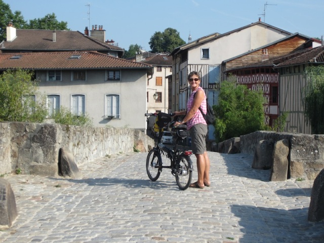 Bev crossing the St Martial Bridge from the 'posh' side of town, into the working class side.