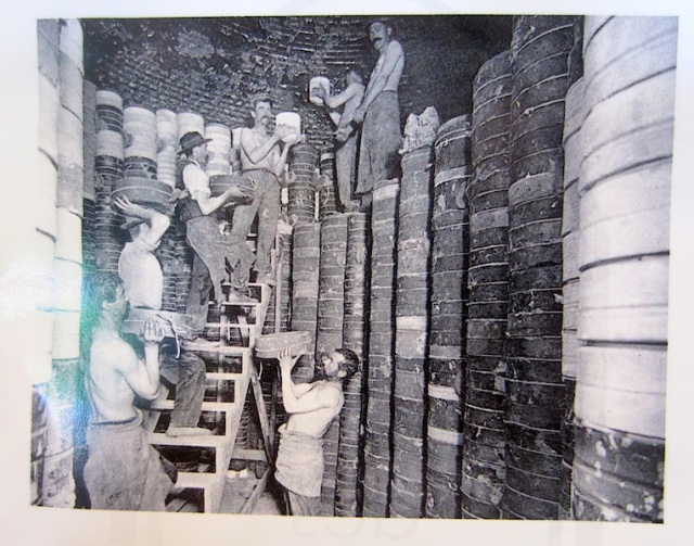 Loading a bottle kiln during the halcyon days of pottery in Limoges..