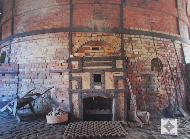 A bottle kiln. I suspect the kiln was fired using wood. It's difficult to comprehend the quantity of wood consumed for a firing in this kiln.