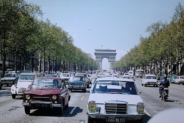 The Champs Elysees and the Arc de Triomphe 1973. I love the vintage cars of the 'Golden Age'. I took this photograph out of the rear window of our VW Beetle.