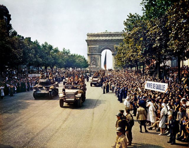 The Champs Elysees and the Arc de Triomphe at the time of liberation 1944. Image credit: Photographer Jack Downey, U.S. Office of War Information. No known publication restrictions. Via Wikipedia.