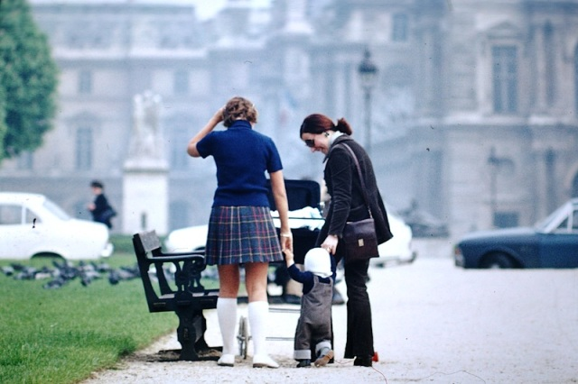 Bev in 1972 dressed in short skirt and long socks talking with a local Parisian mother.