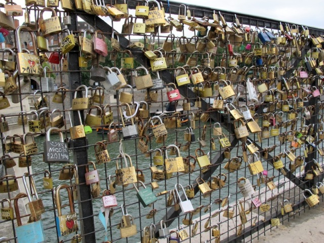Love locks on one of the thirty seven bridges over the River Seine.