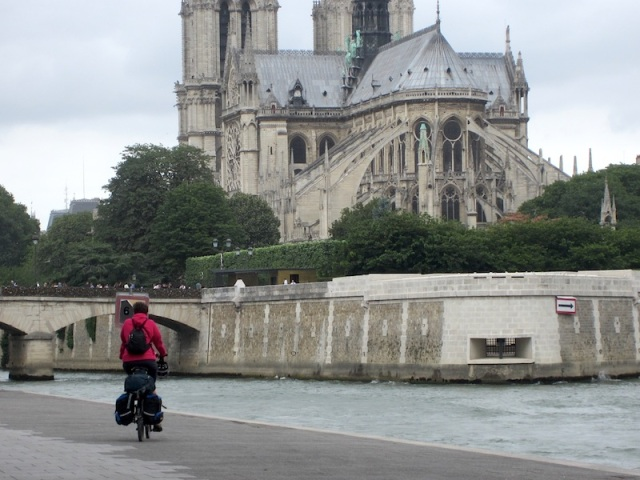 Bev approaching Notre-Dame Cathedral from the chancel end. The delicate flying buttresses supporting the chancel walls are a fine example of the art.