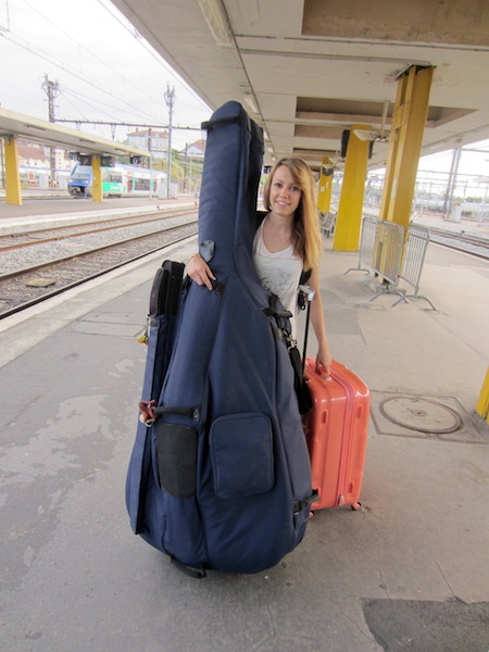 A musician and her double bass shared space with our bikes.