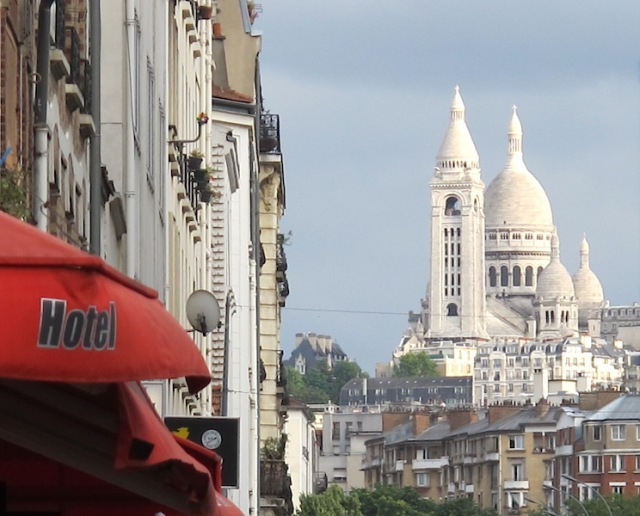 Our backstreet ride to the station. Sacre-Coeur Basilica in the distance and the red awning of Hotel de l'Avenir where we stayed.