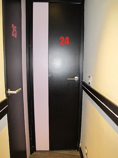 Narrow doors into rooms at Hotel de l'Avenir. I guessed they were about 600mm wide. A standard door is 820mm wide.
