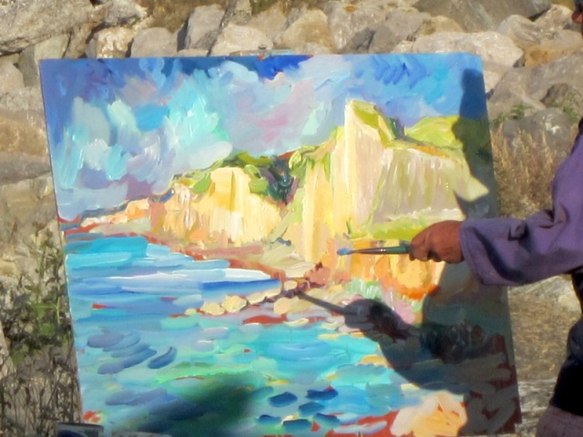 During our ride around Dieppe foreshores we spotted an artist adding a few final dabs to a painting.