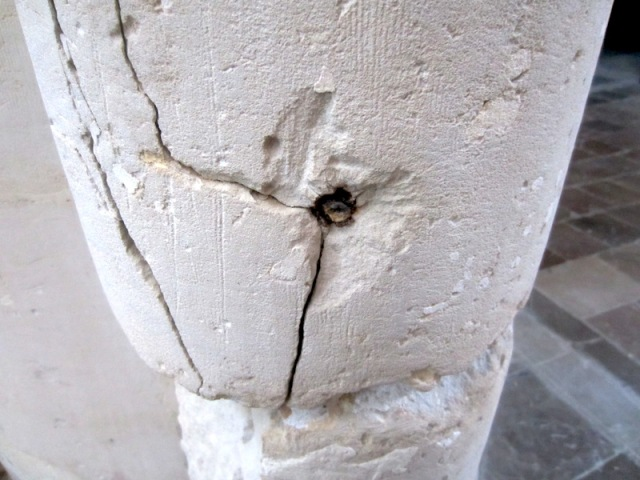 Projectile embedded in a column, a remnant of 'The Raid'.