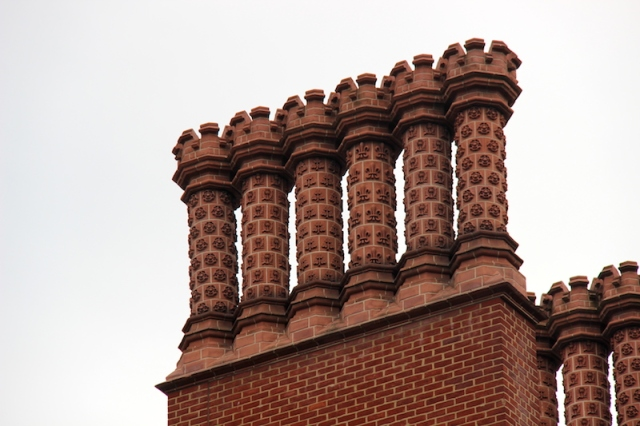 Gothic Tudor-style chimneys were usually tall and thin and often decorated with symmetrical moulded or cut brick. I like to think of chimneys of this style as brick art. (Canon 600D).