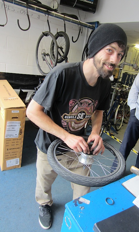 Brian at Williams bike shop, on the job replacing the broken circlip.  The new circlip is on the bench.